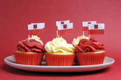Polish red and white decorated cupcakes Stock Photos