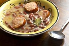 Polish Sauerkraut Soup. Polish sauerkraut, kielbasa, and bean soup with bay leaf garnish Royalty Free Stock Images