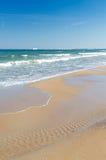Polish sea beach with ferry boat on horizon Royalty Free Stock Photo