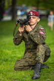 Polish soldier during demonstration of the military and rescue equipment during annual Polish national and public holiday Royalty Free Stock Photos
