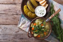Polish soup with sour cucumbers horizontal top view Royalty Free Stock Photo