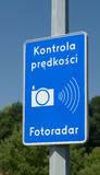 Polish speed camera warning sign. Blue road sign announcing that on this area speed limit is controlled by police camera stock photos