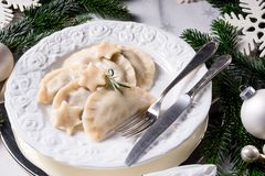 Polish style dumplings filled with sauerkraut and mushrooms. A Polish style dumplings filled with sauerkraut and mushrooms stock images