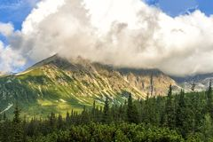 Polish Tatra mountains summer landscape with blue sky and white clouds. royalty free stock photo