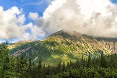 Polish Tatra mountains summer landscape with blue sky and white clouds. Stock Image