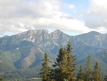 Polish Tatry mountains landscape in summer. Tatry mountains landscape in summer with clouds, blue sky and forest. Giewont peek royalty free stock photography
