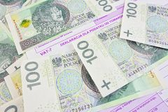 Polish taxes. Polish money together with the tax return Stock Image