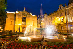 Polish theater with post office building and fountain Stock Image