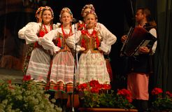 Polish traditional dance ensemble. Women from a Polish traditional dance ensemble - called MALE SLOWIANKI - Krakow, Poland, were present at the International Royalty Free Stock Photo