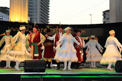 Polish traditional dance stage performance. Polish folklore dance group performing traditional Mazur dance at stage of the International Folk Festival  on Varna Stock Photos
