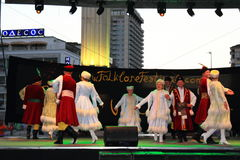 Polish traditional dance stage performance. Polish folklore dance group performing traditional Mazur dance at stage of the International Folk Festival  on Varna Royalty Free Stock Image