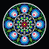 Polish traditional folk art pattern in circle -  Wzory Lowickie on black Stock Photography