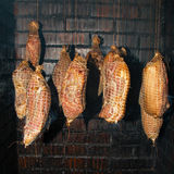 Polish traditional smoked cured meat in the smoking chamber. Polish traditional smoked cured meat and sausages in the smoking chamber. Countryside, slow life Stock Image