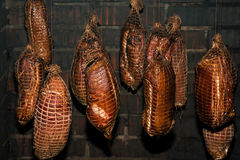 Polish traditional smoked cured meat in the smoking chamber. Polish traditional smoked cured meat and sausages in the smoking chamber. Countryside, slow life Royalty Free Stock Photography