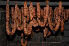 Polish traditional smoked cured meat in the smoking chamber. Polish traditional smoked cured meat and sausages in the smoking chamber. Countryside, slow life Stock Photos