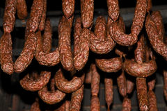 Polish traditional smoked cured meat in the smoking chamber. Polish traditional smoked cured meat and sausages in the smoking chamber. Countryside, slow life Royalty Free Stock Photos