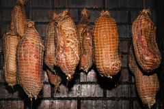 Polish traditional smoked cured meat in the smoking chamber. Polish traditional smoked cured meat and sausages in the smoking chamber. Countryside, slow life Stock Images