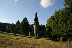 Polish village church. Beautiful stone church in tiny mountain village Zieleńiec, Poland Royalty Free Stock Image