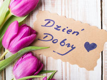 Polish words Good morning and bouquet of tulips. On wooden background royalty free stock photos