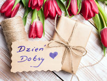 Polish words Good morning and bouquet of tulips. On wooden background Royalty Free Stock Image