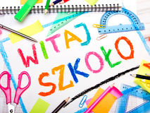Polish words `Welcome back to school` and school accessories. Colorful drawing of the Polish words `Welcome back to school` and school accessories Royalty Free Stock Image