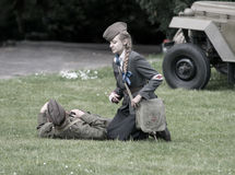 Polish wounded soldier and nurse during historical reenactment of WWII Royalty Free Stock Photos
