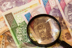 Polish zloty banknotes currency and magnifying glass Royalty Free Stock Photography