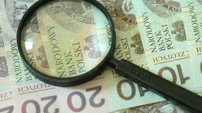 Polish zloty banknotes with magnifying glas Royalty Free Stock Photography