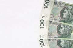 Polish zloty banknotes on white paper background closeup. Royalty Free Stock Photo