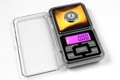 Polish zloty coin on scales, shows zero weight. Currency inflation concept royalty free stock photo