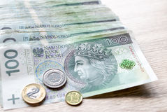 Polish zloty currency hundred notes in white envelop on table. C Royalty Free Stock Images