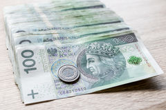 Polish zloty currency hundred notes in white envelop on table. C Stock Photography