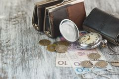 Polish zloty with little wallets and pocket clock Stock Photos
