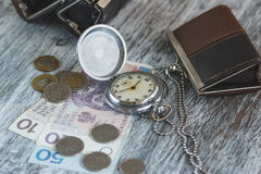 Polish zloty with little wallets and pocket clock Royalty Free Stock Images