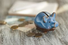 Polish zloty, notebook and piggy bank on the wooden background Royalty Free Stock Photography
