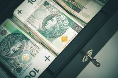 Polish Zloty in Safe Box Stock Images