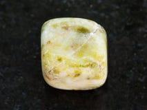 Polished agate gem stone on dark background Stock Photo