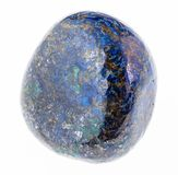 Polished azurite (chessylite) gemstone on white. Macro photography of natural mineral from geological collection - polished azurite (chessylite) gemstone on royalty free stock photo