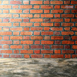 Polished bare concrete floor and red brick wall Royalty Free Stock Photo