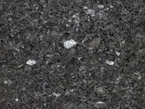 Polished Black Granite. A detail shot of a slab of black Granite highly polished showing crystalline structure stock photos