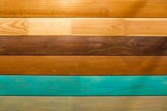 Polished Board. Different types of wood. White oak. Bog oak. Light walnut. Green, yellow, brown. royalty free stock photo