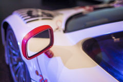 Polished Body and Mirror of Brand New Racing car Royalty Free Stock Photos