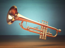 Polished brass trumpet on green background. Stock Images