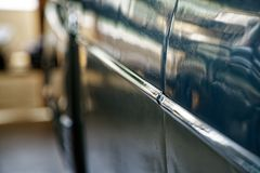 Polished car body with light reflection, sunny bunny on old vintage car, business consept stock photo
