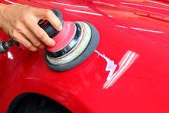 Polished car. Power buffering machine used for polishing cars Stock Photography