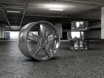 Polished chrome rim wheels in garage Royalty Free Stock Photos