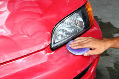 Polished and coating wax car. Hand with polished and coating wax car Royalty Free Stock Photos