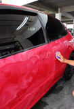 Polished and coating wax car. Hand with polished and coating wax car Stock Images