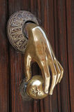 Polished copper doorknocker Royalty Free Stock Photo