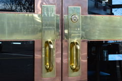 Polished door handles. Polished brass and copper door handles Stock Image